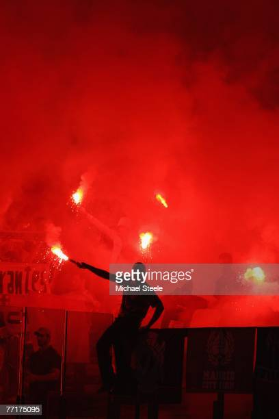 Real Madrid fans light flares during the UEFA Champions League Group C match between Lazio and Real Madrid at the Olympic Stadium on October 3 2007...