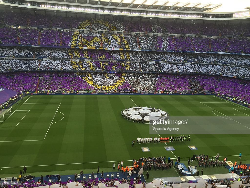 Real Madrid fans make a mosaic before the UEFA Champions League semi-final second leg football match between Real Madrid and Manchester City at the Santiago Bernabeu Stadium in Madrid, on May 4, 2016.