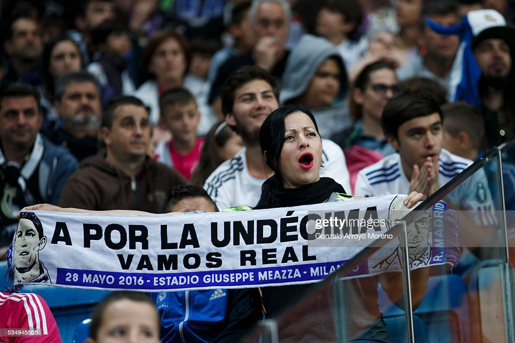 Real Madrid fans react at Estadio Santiago Bernabeu during the UEFA Champions League Final match between Real Madrid CF and Club Atletico de Madrid on May 28, 2016 in Madrid, Spain. More than 85,000 Santiago Bernabeu seats have been sold out to watch on giant screens the UEFA Champions League Final which is being held in Milan.