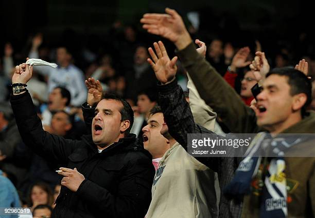 Real Madrid fans react in anger during the Copa del Rey fourth round second leg match between Real Madrid and AD Alcorcon at the Estadio Santiago...