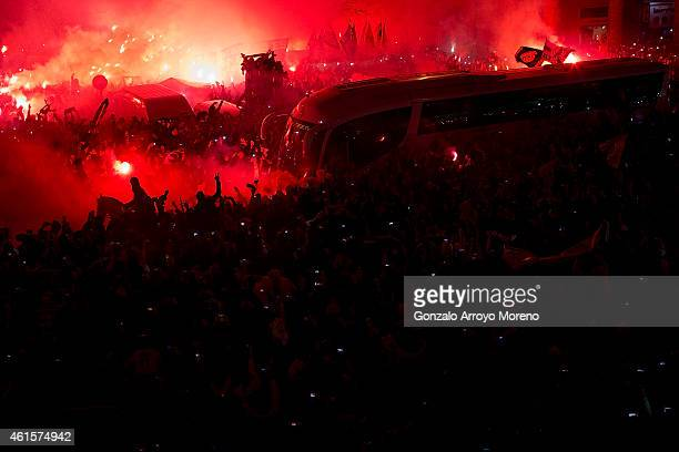 Real Madrid fans receive the bus carrying their team with flares before the Copa del Rey Round of 16 second leg match between Real Madrid CF and Club...