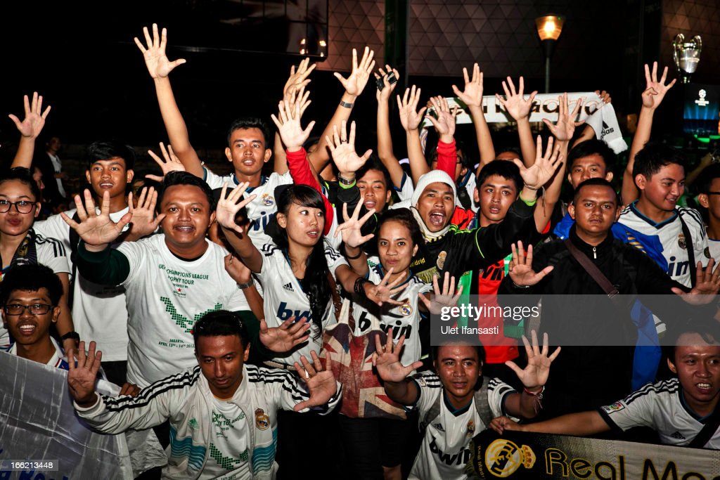 Real Madrid fans show their enthusiasm during the trophy unveiling as part of the UEFA Champions League Trophy Tour 2013 presented by Heineken at Gandaria City Shopping Mall on April 10, 2013 in Jakarta, Indonesia.