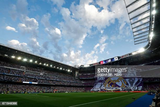 Real Madrid fans unfold a big banner on the stands before the Spanish league football match Real Madrid CF vs FC Barcelona at the Santiago Bernabeu...