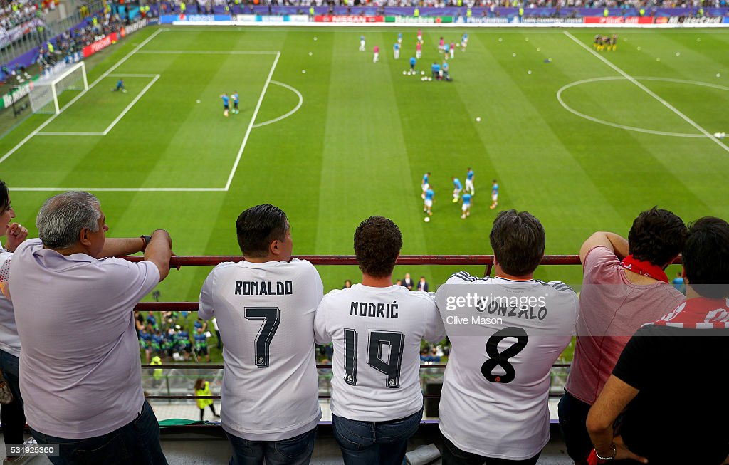 Real Madrid fans watch from the stands prior to the UEFA Champions League Final match between Real Madrid and Club Atletico de Madrid at Stadio Giuseppe Meazza on May 28, 2016 in Milan, Italy.
