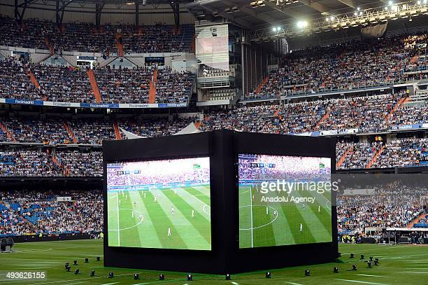 Real Madrid fans watch the UEFA Champions League football final match between Atletico Madrid vs Real Madrid on a big screen at the Santiago Bernabeu...
