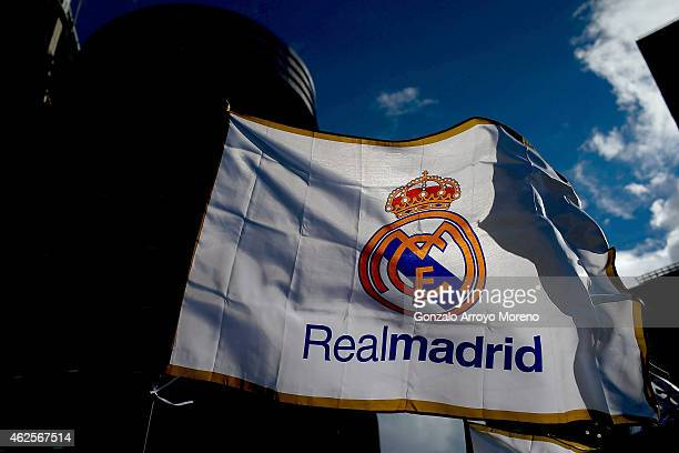 Real madrid flag flutters displayed at a merchandaising stall at Estadio Santiago Bernabeu outdoors before the La Liga match between Real Madrid CF...