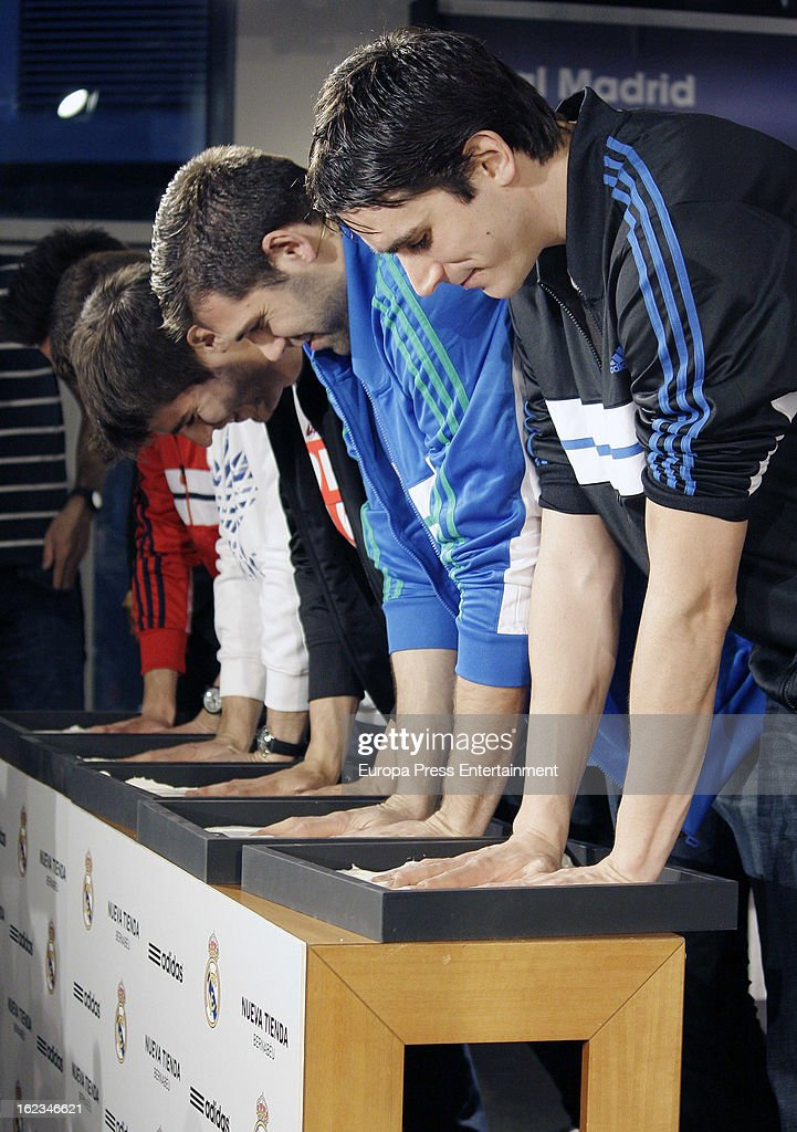 Real Madrid football and basketball players Jose Callejon, Nacho Fernandez, Alvaro Morata, <a gi-track='captionPersonalityLinkClicked' href=/galleries/search?phrase=Felipe+Reyes&family=editorial&specificpeople=732755 ng-click='$event.stopPropagation()'>Felipe Reyes</a> and Carlos Suarez attend the opening of the new 'Adidas' store at the Santiago Bernabeu stadium on February 21, 2013 in Madrid, Spain.