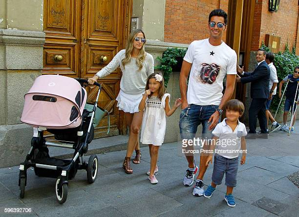 Part of this image has been pixellated to obscure the identity of the child Real Madrid football player Alvaro Arbeloa his wife Carlota Ruiz and...