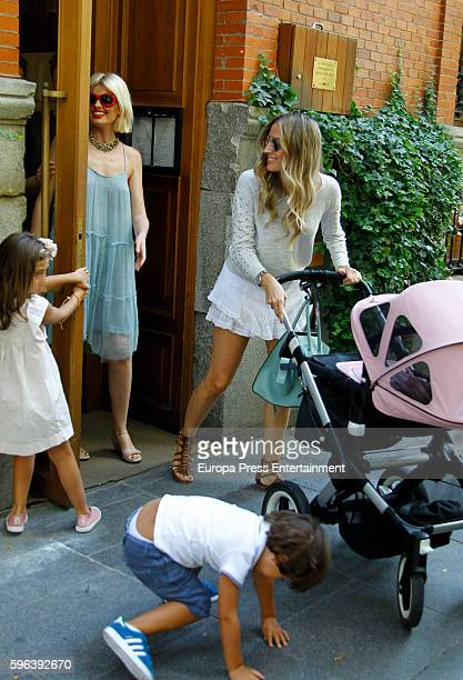 Part of this image has been pixellated to obscure the identity of the child Real Madrid football player Alvaro Arbeloa's wife Carlota Ruiz her kids...