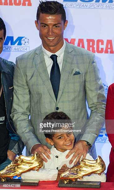 Real Madrid football player Cristiano Ronaldo and his son Cristiano Ronaldo jr attend the award ceremony to present Cristiano Ronaldo with his fourth...