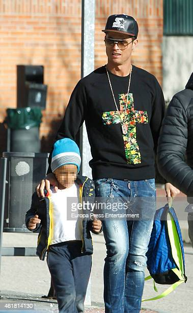 Real Madrid football player Cristiano Ronaldo is seen with his son Cristiano Ronaldo Jr at school on January 19 2015 in Madrid Spain
