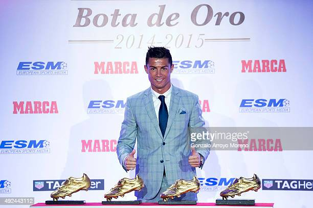 Real Madrid football player Cristiano Ronaldo poses with his four Golden Boot Awards as maximun goal scorer of European leagues at The Westin Palace...
