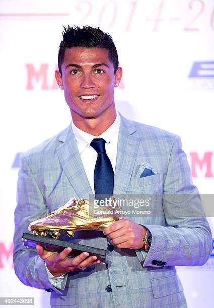 Real Madrid football player Cristiano Ronaldo poses with his fourth Golden Boot Award as maximun goal scorer of European leagues at The Westin Palace...