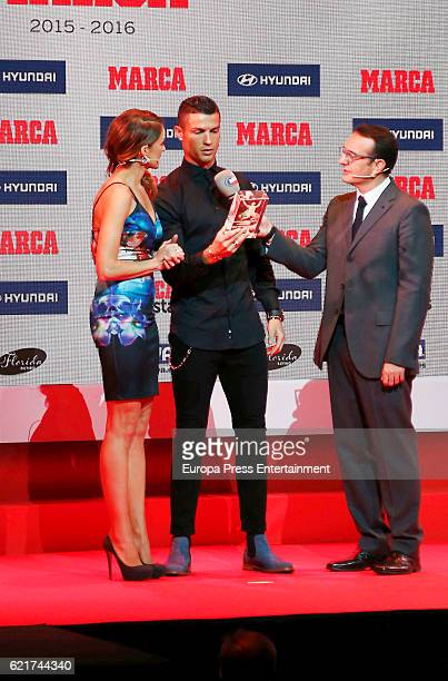 Real Madrid football player Cristiano Ronaldo receives from hand of Monica Martinez the Alfredo Di Stefano Award for the Best Player of the 2015/16...
