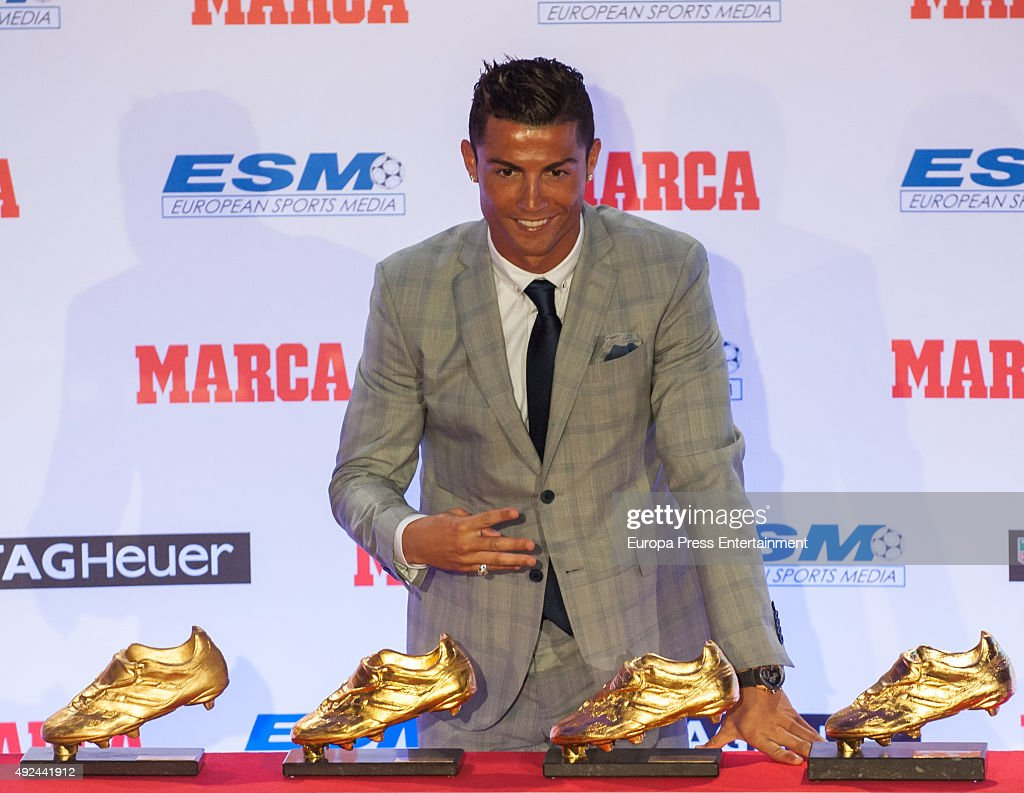 Real Madrid football player Cristiano Ronaldo receives his fourth Golden Boot Award as the highest goal scorer of the European leagues on October 13, 2015 in Madrid, Spain.