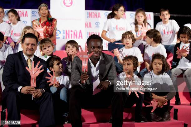 Real Madrid football player Michael Essien attends the 'International Day of The Girl' Illumination at the Santiago Bernabeu Stadium on October 11...