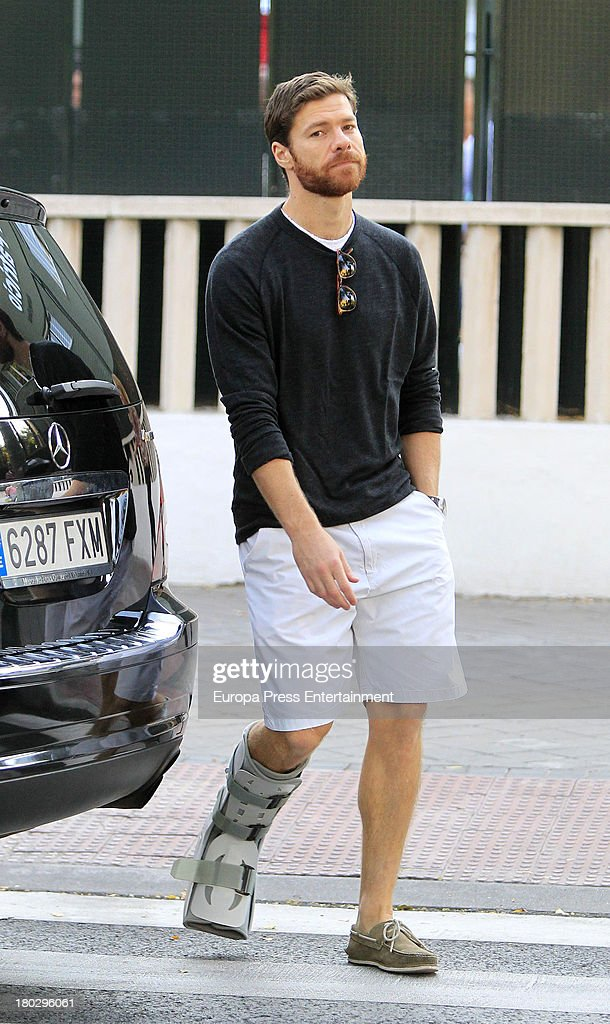 Real Madrid football player Xabi Alonso is seen wearing a leg cast on September 10 2013 in Madrid Spain