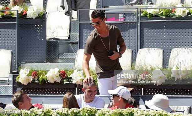 Real Madrid football players Cristiano Ronaldo Pepe and Toni Kroos attend the Mutua Madrid Open tennis tournament at La Caja Magica on May 7 2015 in...