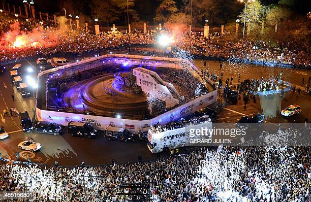 Real Madrid football squad's bus parades at Plaza Cibeles in Madrid as they celebrate their victory over Barcelona in the Spanish Copa del Rey final...