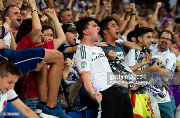Real Madrid football team fans celebrate their team's second goal on the stands of the Santiago Bernabeu stadium in Madrid on June 3 2017 during the...