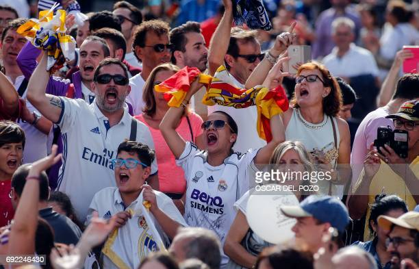Real Madrid football team fanS celebratE their team's victory at the Plaza Cibeles in Madrid on June 4 2017 Real Madrid made history yesterday in...