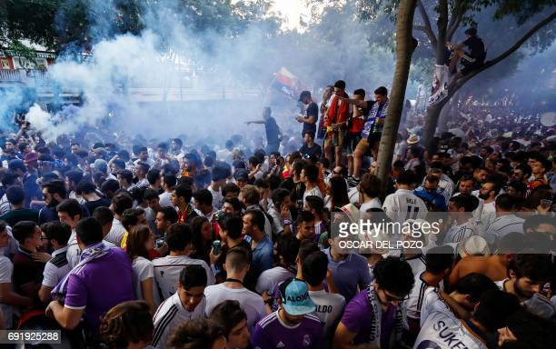 Real Madrid football team fans gather to cheer their team in the surroundings of the Santiago Bernabeu stadium in Madrid on June 3 2017 during the...