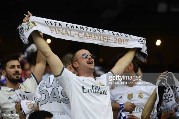 Real Madrid football team fans shout in the tribune at the Santiago Bernabeu stadium in Madrid on June 3 2017 before the UEFA Champions League...