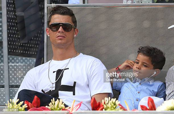 Real Madrid footballer Cristiano Ronaldo and his son Cristiano Ronaldo Junior watch Rafael Nadal of Spain against Jarkko Nieminen of Finland in their...