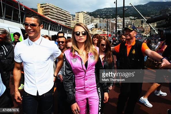 Real Madrid footballer Cristiano Ronaldo and model Cara Delevingne are seen in the pitlane before the Monaco Formula One Grand Prix at Circuit de...
