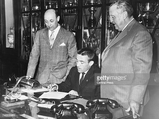 Real Madrid footballer Luis del Sol signs his transfer to Italian team Juventus Torino in the presence of Real president Santiago Bernabeu and...