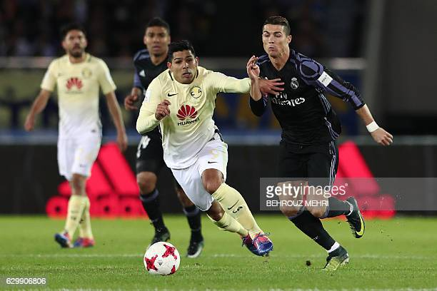 Real Madrid forward Cristiano Ronaldo fights for the ball with Club America forward Silvio Romero during the Club World Cup semifinal football match...