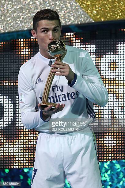 Real Madrid forward Cristiano Ronaldo receives the Golden Ball trophy after winning the Club World Cup football final match against Kashima Antlers...
