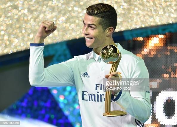 Real Madrid forward Cristiano Ronaldo receives the Golden Ball trophy after winning the Club World Cup football final match between Kashima Antlers...