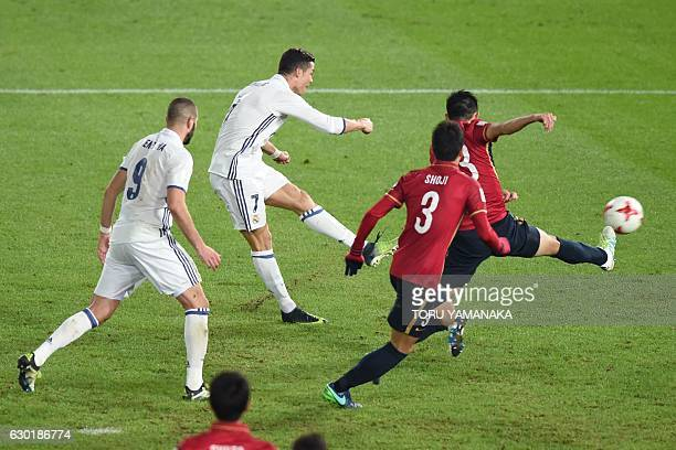 Real Madrid forward Cristiano Ronaldo shoots to score during extratime of the Club World Cup football final match between Kashima Antlers of Japan...