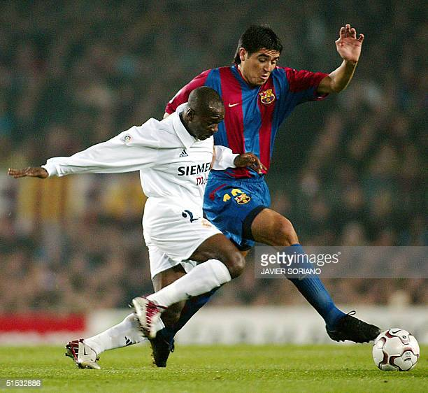 Real Madrid French Claude Makelele vies with Barcelona' Argentine Juan Roman Riquelme in a Liga match BarcelonaReal Madrid in Camp Nou Stadium in...