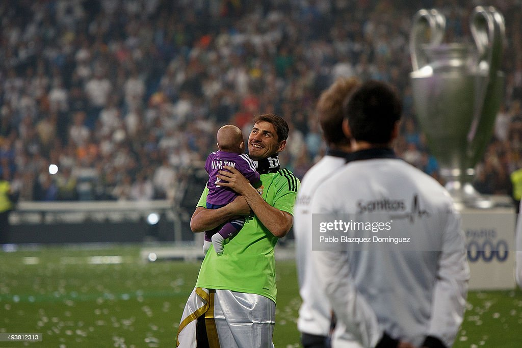 Real Madrid goal keeper <a gi-track='captionPersonalityLinkClicked' href=/galleries/search?phrase=Iker+Casillas&family=editorial&specificpeople=215446 ng-click='$event.stopPropagation()'>Iker Casillas</a> holds his son during the Real Madrid celebration the day after winning the UEFA Champions League final at Santiago Bernabeu Stadium on May 25, 2014 in Madrid, Spain. Real Madrid CF achieves their tenth European Cup at Lisbon at Lisbon 12 years later.