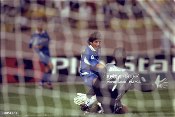 Real Madrid goalkeeper Bodo Illgner saves from Chelsea's Gianfranco Zola