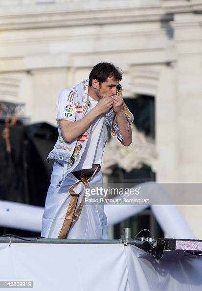 Real Madrid Goalkeeper Iker Casillas kisses his team's shield while he celebrates at Cibeles Square on May 3 in Madrid Spain Real Madrid are...