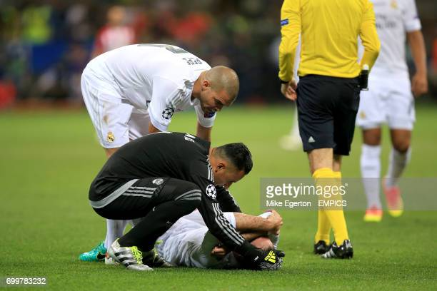 Real Madrid goalkeeper Keylor Navas and defender Pepe check of teammate Daniel Carvajal after he suffered an injury