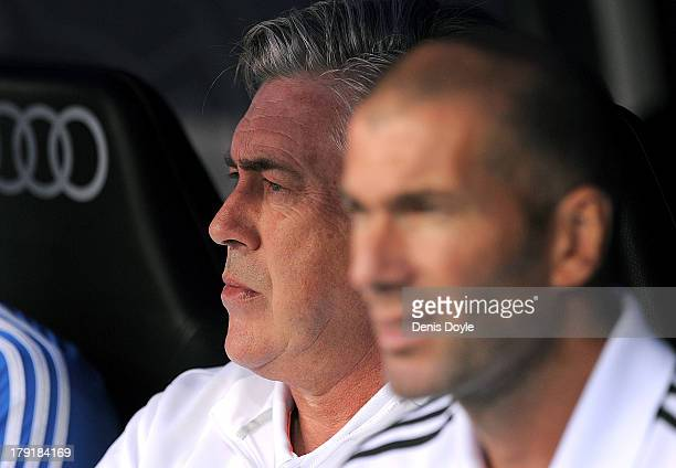 Real Madrid head coach Carlo Ancelotti looks on beside assistant coach Zinedine Zidane during the La Liga match between Real Madrid CF and Athletic...