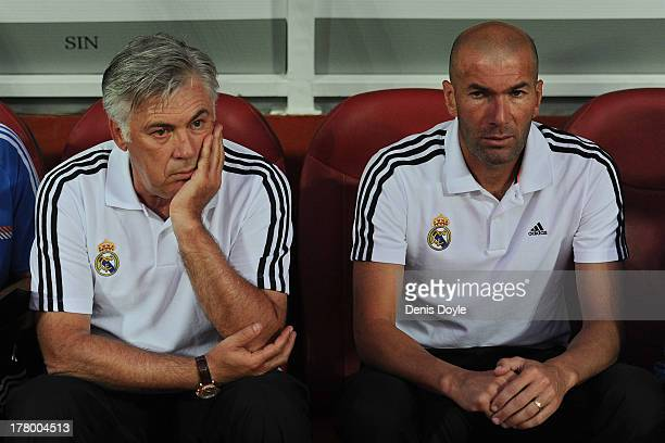 Real Madrid head coach Carlo Ancelotti looks on with his assistent Zinedine Zidane during the La Liga match between Granada CF and Real Madrid CF at...