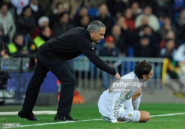 Real Madrid head coach Jose Mourinho encourages Mesut Ozil during the La Liga match between Real Madrid and RCD Espanyol at Estadio Santiago Bernabeu...