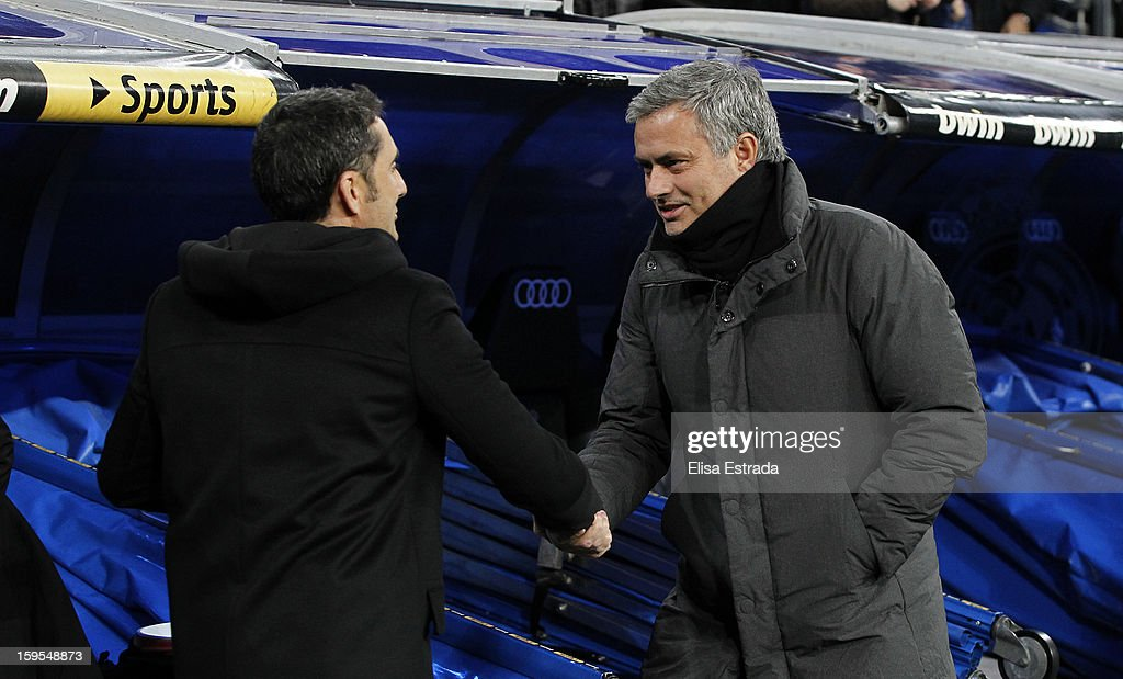 Real Madrid head coach Jose Mourinho (R) greets Valenca head coach <a gi-track='captionPersonalityLinkClicked' href=/galleries/search?phrase=Ernesto+Valverde&family=editorial&specificpeople=2498803 ng-click='$event.stopPropagation()'>Ernesto Valverde</a> before the Copa del Rey Quarter Final match between Real Madrid and Valencia at Estadio Santiago Bernabeu on January 15, 2013 in Madrid, Spain.