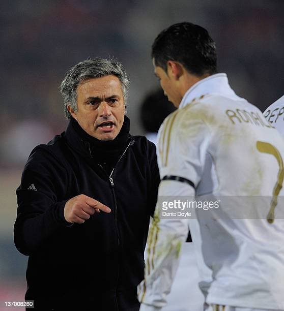Real Madrid head coach Jose Mourinho has a word with Cristiano Ronaldo during the La Liga match between RCD Mallorca and Real Madrid at Iberostar...