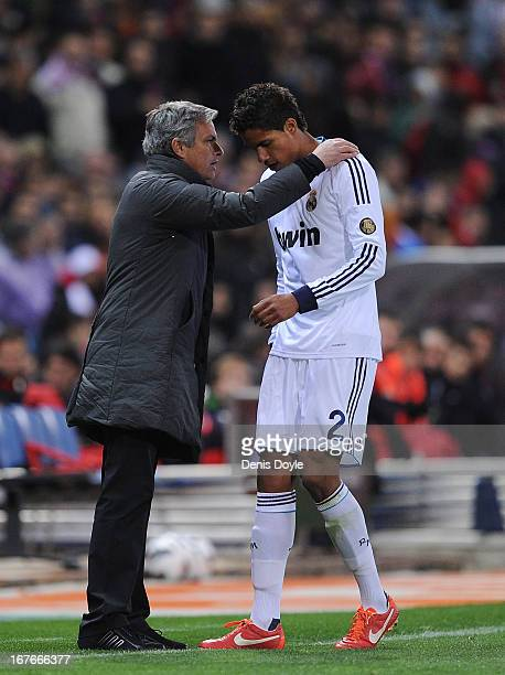 Real Madrid head coach Jose Mourinho has a word with Raphael Verane of Real Madrid during the La Liga match between Atletico de Madrid and Real...
