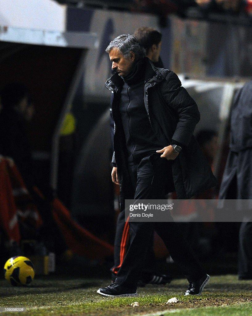 Real Madrid head coach Jose Mourinho walks back to the bench during the La Liga match between Osasuna and Real Madrid at estadio Reino de Navarra on January 12, 2013 in Pamplona, Spain.