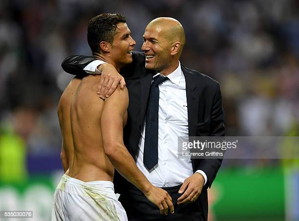 Real Madrid head coach Zinedine Zidane hugs a smiling Cristiano Ronaldo of Real Madrid after the UEFA Champions League Final match between Real...