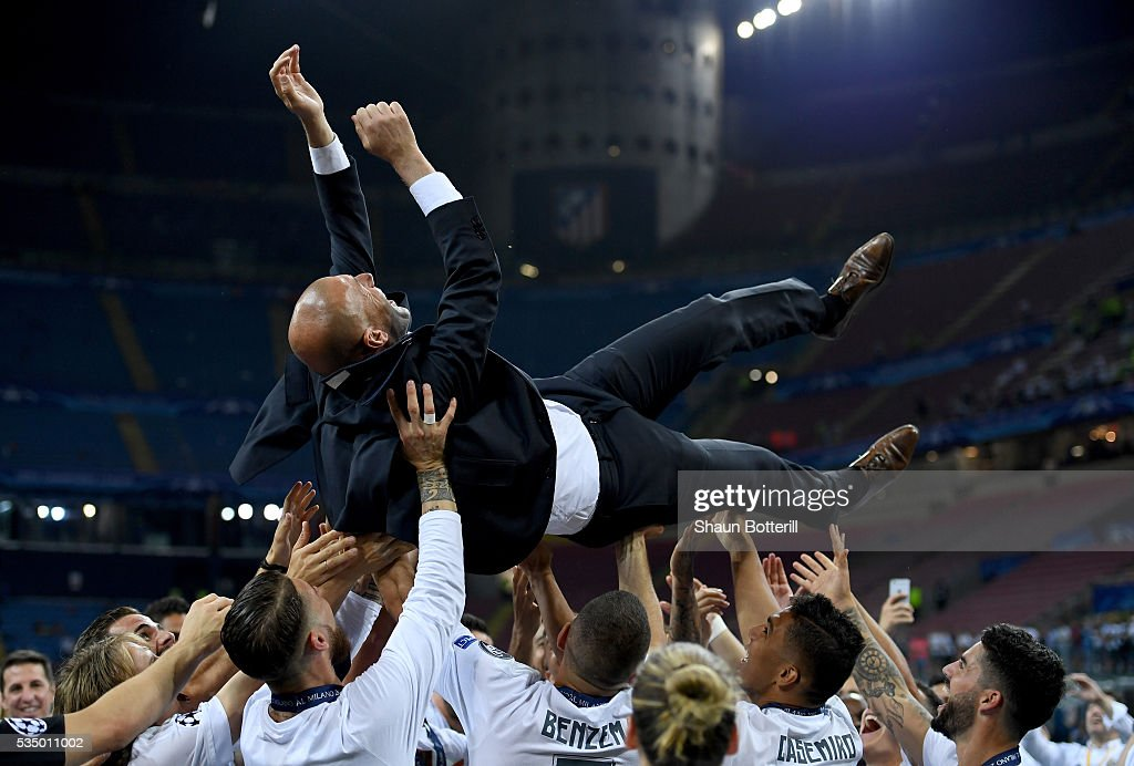 Real Madrid head coach <a gi-track='captionPersonalityLinkClicked' href=/galleries/search?phrase=Zinedine+Zidane&family=editorial&specificpeople=172012 ng-click='$event.stopPropagation()'>Zinedine Zidane</a> is thrown in the air after the UEFA Champions League Final match between Real Madrid and Club Atletico de Madrid at Stadio Giuseppe Meazza on May 28, 2016 in Milan, Italy.