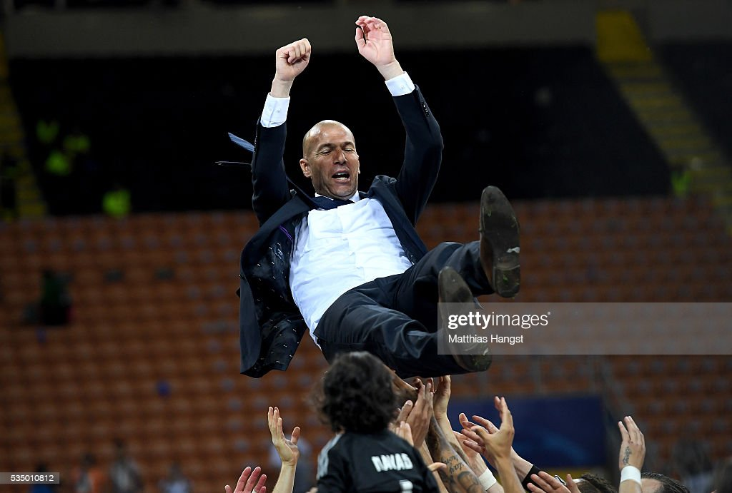 Real Madrid head <a gi-track='captionPersonalityLinkClicked' href=/galleries/search?phrase=Zinedine+Zidane&family=editorial&specificpeople=172012 ng-click='$event.stopPropagation()'>Zinedine Zidane</a> is thrown in the air after the UEFA Champions League Final match between Real Madrid and Club Atletico de Madrid at Stadio Giuseppe Meazza on May 28, 2016 in Milan, Italy.