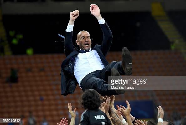 Real Madrid head Zinedine Zidane is thrown in the air after the UEFA Champions League Final match between Real Madrid and Club Atletico de Madrid at...